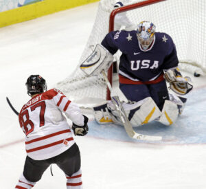Sidney Crosby (Canada) scores the winning goal vs Ryan Miller (USA)