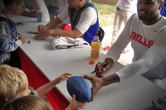 Bills Rookie QB, E.J. Manuel signs Cam's blue football—with a personalized birthday message!