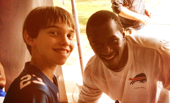 Bills DB, Leodis McKelvin, posing for a photo with Alex (and signing his autograph book)